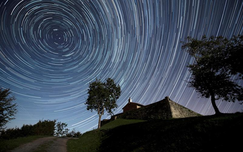 A meteor shower over the chapel of St. Stephen, in the town of Comillas, northern Spain, taken earlier this month - REX