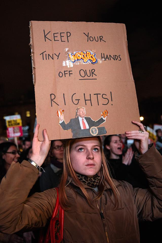 <p>A protester holds up a placard during a rally against U.S. President Donald Trump, Feb. 20, 2017, in London. (Photo: Jack Taylor/Getty Images) </p>