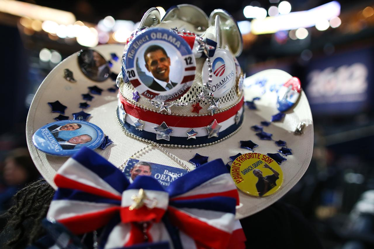 CHARLOTTE, NC - SEPTEMBER 06:  Renee Watson of San Antonio, TX wears a cowboy hat decorated with campaign buttons during the final day of the Democratic National Convention at Time Warner Cable Arena on September 6, 2012 in Charlotte, North Carolina. The DNC, which concludes today, nominated U.S. President Barack Obama as the Democratic presidential candidate.  (Photo by Tom Pennington/Getty Images)