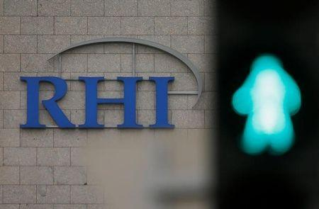 The logo of Austrian specialised fireproof materials maker RHI is pictured behind a traffic light at an office park building where its headquarters are located in Vienna