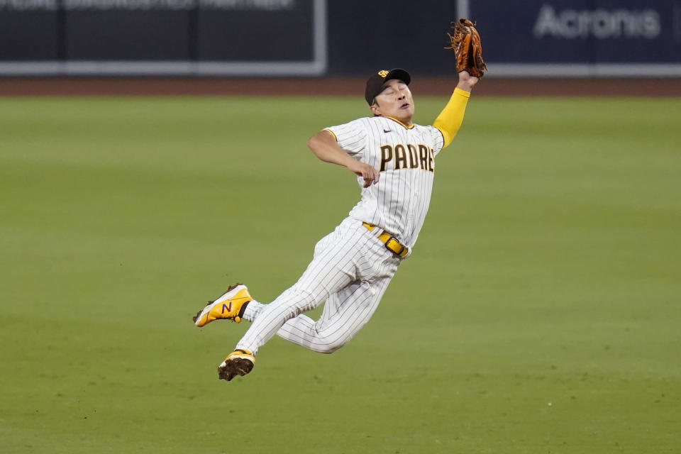 San Diego Padres second baseman Ha-Seong Kim makes a leaping catch for the out on Los Angeles Dodgers' Billy McKinney during the seventh inning of a baseball game Thursday, Aug. 26, 2021, in San Diego. (AP Photo/Gregory Bull)
