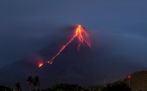 <span>Lava cascades down the slopes of Mayon volcano, about 210 miles south-east of Manila, Philippines</span> <span>Credit: AP </span>