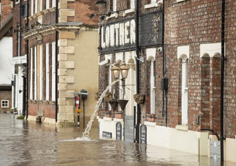 Flooding water is pumped from the Lowther pub in York after the River Ouse burst its banks, as a third consecutive weekend of stormy weather is bringing further flooding misery to already sodden communities.