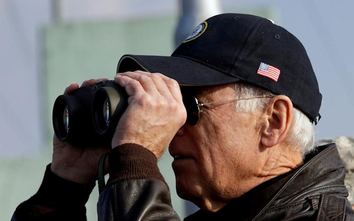 Vice President Joe Biden looks through binoculars to see North Korea from Observation Post Ouellette during a tour of the DMZ in 2013 - Reuters