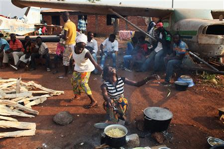 Families, displaced from violence, take shelter at the airport in capital Bangui
