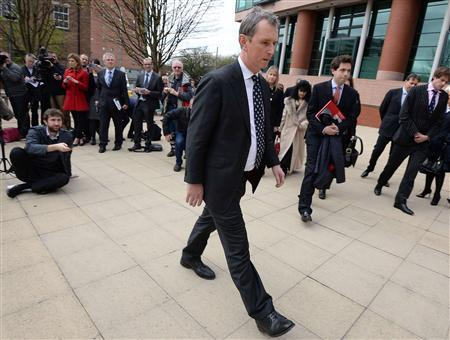 Former deputy speaker of the House of Commons Nigel Evans leaves after speaking to the media outside Preston Crown Court, northern England April 10, 2014. REUTERS/Nigel Roddis