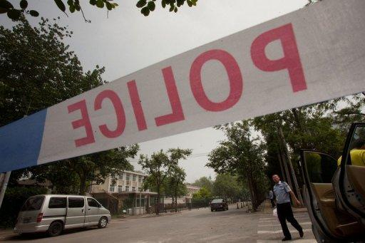 A Chinese policeman cordons off a road in Beijing