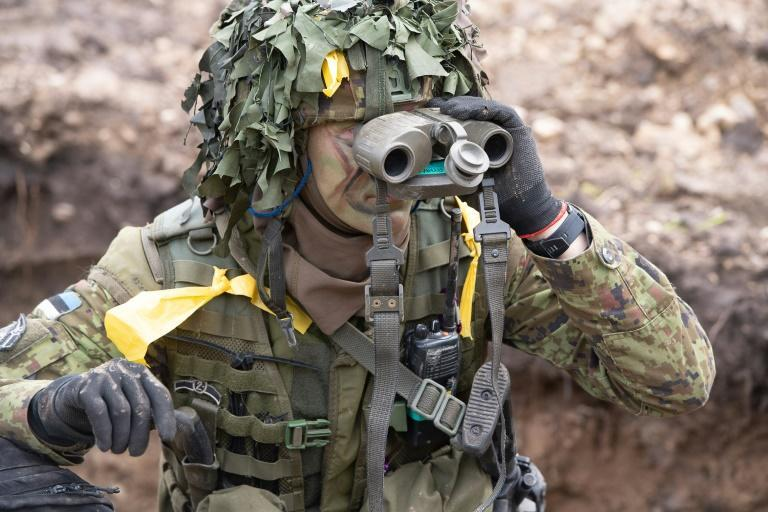 """In the exercise, the NATO allies are engaging an enemy named """"Merinus"""" whose soldiers wear yellow tags to identify themselves"""