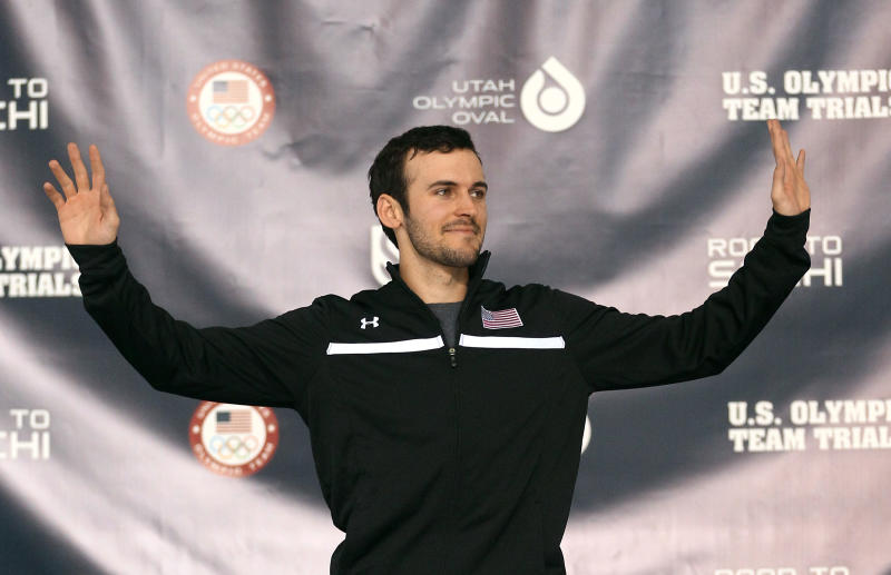 Mitchell Whitmore celebrates on the podium following his win in the men's 500 meters during the U.S. Olympic speedskating trials Saturday, Dec. 28, 2013, in Kearns, Utah. (AP Photo/Rick Bowmer)