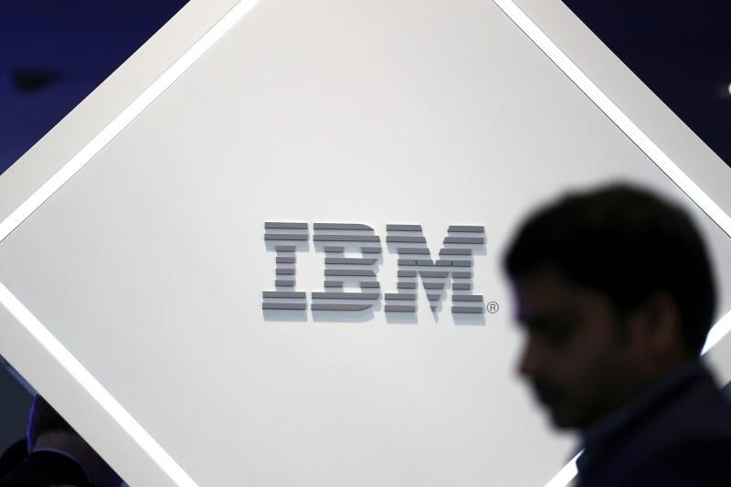 Man stands near an IBM logo at the Mobile World Congress in Barcelona