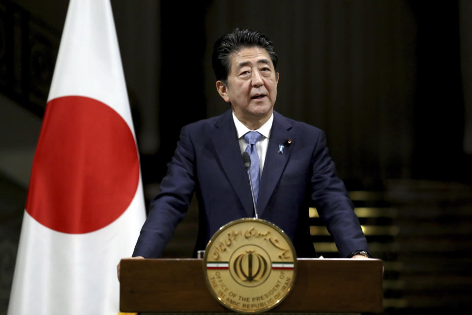 Japanese Prime Minister Shinzo Abe speaks with media during a joint press conference with Iranian President Hassan Rouhani, after their meeting at the Saadabad Palace in Tehran, Iran, Wednesday, June 12, 2019. The Japanese leader is in Tehran on an mission to calm tensions between the U.S. and Iran. (AP Photo/Ebrahim Noroozi)
