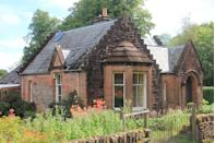 """<p>This traditional baronial lodge house has breathtaking gardens, colourful flowerbeds, a large bright living room, covered patio area, three bedrooms and an entrance vestibule. Better still, it's for sale by public auction with a £140,000 guide price...</p><p><a href=""""https://www.onthemarket.com/details/9550470/"""" rel=""""nofollow noopener"""" target=""""_blank"""" data-ylk=""""slk:This property is currently on the market for £140,000 with Town & Country Property Auctions Scotland at OnTheMarket"""" class=""""link rapid-noclick-resp"""">This property is currently on the market for £140,000 with Town & Country Property Auctions Scotland at OnTheMarket</a> </p>"""