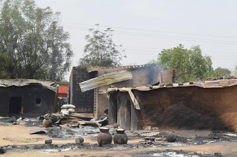 This photo shows razed homes in Mainok, outside Maiduguri on March 6, 2014 (AFP Photo/)