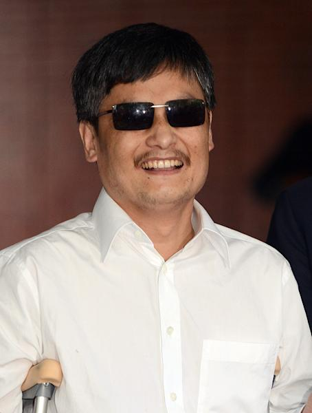 Blind Chinese legal activist Chen Guangcheng arrives at Washington Square Village on the campus of New York University, Saturday, May 19, 2012, in New York. Chen escaped from his village in April and was given sanctuary inside the U.S. Embassy after seven years of prison and house arrest. He is planning to study law at NYU. But before that, he says he is planning to spend time recuperating. (AP Photo/Henny Ray Abrams)