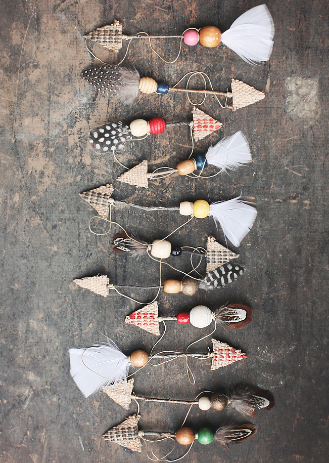 """<p>Take a more bohemian approach with your ornaments by making arrows with twigs, feathers, and wooden beads. </p><p><strong>Get the tutorial at <a href=""""http://www.thoughtsfromalice.com/2014/12/diy-rustic-boho-twig-arrow-ornaments.html"""" rel=""""nofollow noopener"""" target=""""_blank"""" data-ylk=""""slk:Thoughts From Alice"""" class=""""link rapid-noclick-resp"""">Thoughts From Alice</a>.</strong></p><p><a class=""""link rapid-noclick-resp"""" href=""""https://www.amazon.com/Touch-Nature-Feather-Value-Natural/dp/B00E1CMUPQ/?tag=syn-yahoo-20&ascsubtag=%5Bartid%7C10050.g.1070%5Bsrc%7Cyahoo-us"""" rel=""""nofollow noopener"""" target=""""_blank"""" data-ylk=""""slk:SHOP FEATHERS"""">SHOP FEATHERS</a></p>"""