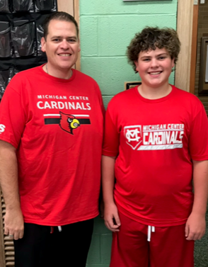 Jackson, Michigan science teacher Corey Shelton, seen here with his son Logan, is concerned about how Senate Majority Leader Mitch McConnell's proposal to allow states to file for bankruptcy would affect his pension.