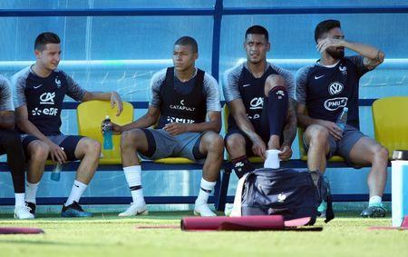 Soccer Football - World Cup - France Training - France Training Camp, Moscow, Russia - June 18, 2018 France's Kylian Mbappe, Alphonse Areola, Olivier Giroud and Florian Thauvin with team mates during training REUTERS/Albert Gea