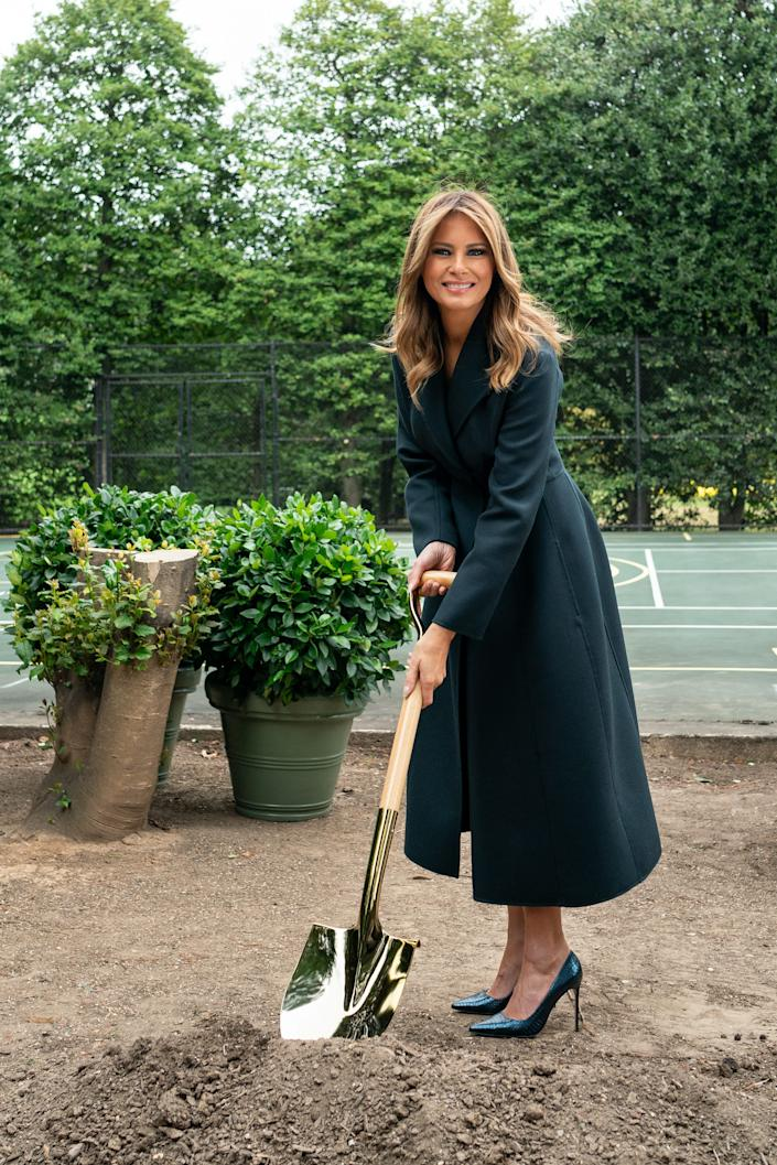 First Lady Melania Trump turns soil with a ceremonial shovel at the groundbreaking ceremony for the White House Tennis Pavilion on Tuesday, Oct. 8, 2019, on the south grounds of the White House.
