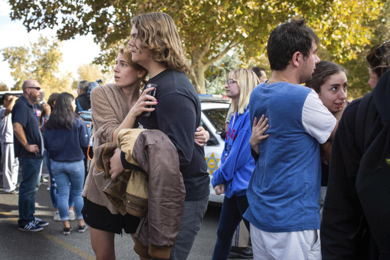Saugus High School students reunite with their families in Central Park following a shooting that injured several people at Saugus High School, Thursday, Nov. 14, 2019, in Santa Clarita, Calif. (Sarah Reingewirtz/The Orange County Register via AP)