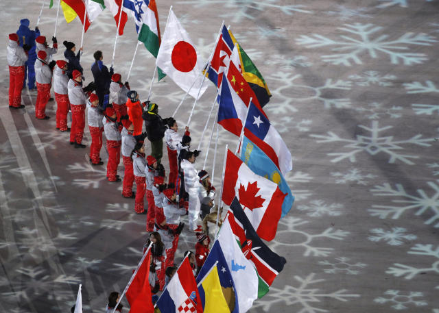 <p>Flag bearers from various nations attend the closing ceremony of the 2018 Winter Olympics in Pyeongchang, South Korea, Sunday, Feb. 25, 2018. (AP Photo/Charlie Riedel) </p>