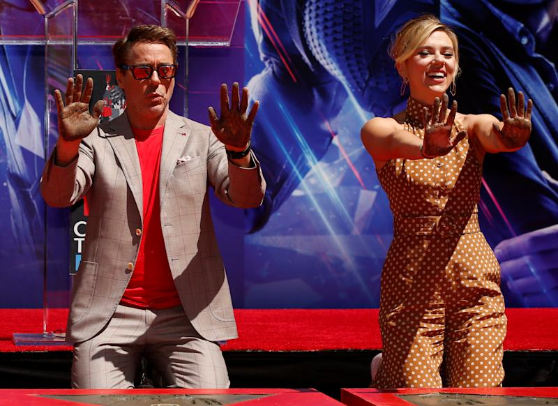 Actors Robert Downey Jr. and Scarlett Johansson show their hands after placing them in cement at a ceremony at the TCL Chinese Theatre in Hollywood, Los Angeles, California, U.S. April 23, 2019. REUTERS/Mario Anzuoni