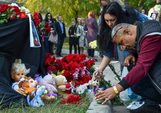 People laid flowers for victims of the shooting at a college in Kerch, Crimea