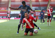 Arsenal's Thomas Partey, background tackles Southampton's Ryan Bertrand during the FA Cup fourth round soccer match between Southampton and Arsenal, at St. Mary's Stadium, in Southampton, England, Saturday Jan. 23, 2021. (Catherine Ivill/PA via AP)