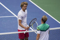 Alexander Zverev, of Germany, greets Alejandro Davidovich Fokina, of Spain, after winning their fourth-round of the US Open tennis championships, Sunday, Sept. 6, 2020, in New York. (AP Photo/Seth Wenig)