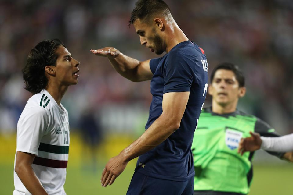 It didn't appear Matt Miazga (right) and Diego Lainez got along particularly well Tuesday night. (Getty)