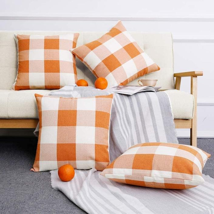 <p>This <span>Volcanics Buffalo Check Plaid Throw Pillow Covers Set</span> ($15) will add some colorful vibes to your sofa.</p>