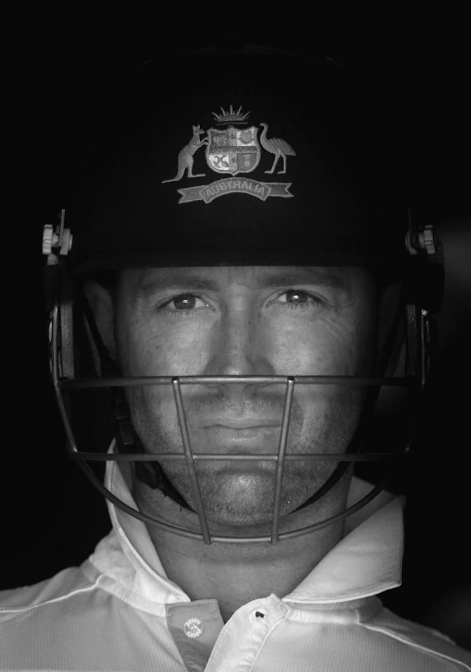 BRISBANE, AUSTRALIA - NOVEMBER 12: (Editor's Note: This image has been converted to black and white) Michael Clarke of Australia walks out to bat during day four of the First Test match between Australia and South Africa at The Gabba on November 12, 2012 in Brisbane, Australia.  (Photo by Ryan Pierse/Getty Images)