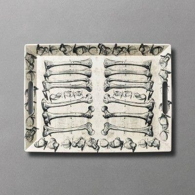 """<p><strong>John Derian for Threshold</strong></p><p>target.com</p><p><strong>$20.00</strong></p><p><a href=""""https://www.target.com/p/19-31-34-x-14-25-34-bone-to-pick-bone-print-serving-tray-john-derian-for-threshold-8482/-/A-79502742"""" rel=""""nofollow noopener"""" target=""""_blank"""" data-ylk=""""slk:Shop Now"""" class=""""link rapid-noclick-resp"""">Shop Now</a></p><p>This tray with illustrations of bones is <em>fa-boo-lous</em> for serving or for having on display for decor–plus it's dishwasher safe. We love that!</p>"""