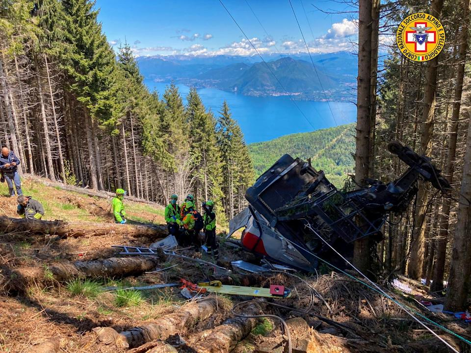 A crashed cable car is seen after it collapsed in Stresa, near Lake Maggiore, Italy.