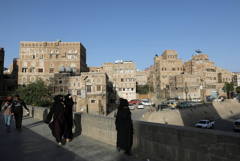 People walk in the old quarter of Sanaa