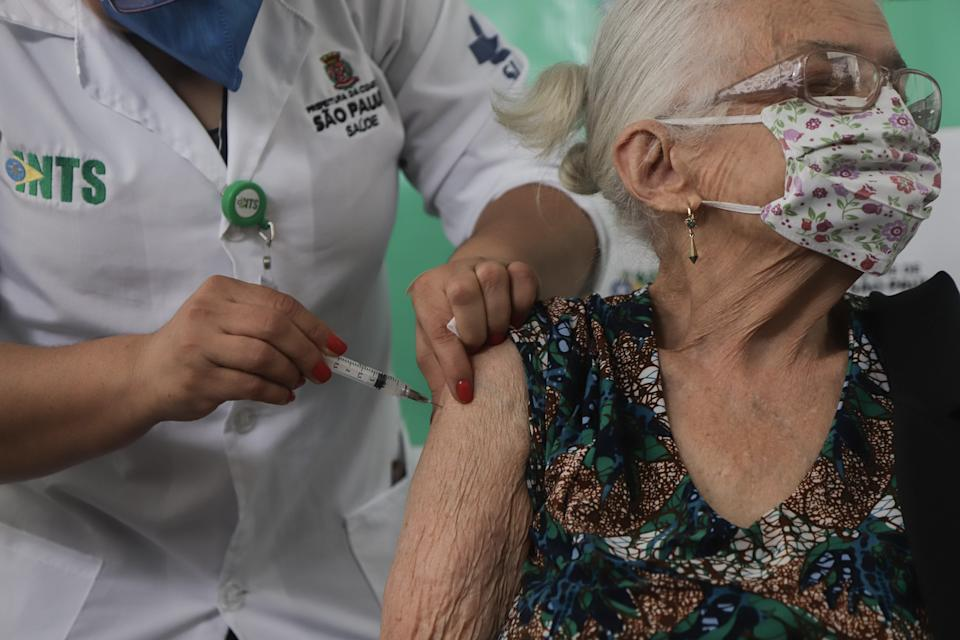 SAO PAULO, Feb. 5, 2021 -- A woman receives a dose of CoronaVac, a vaccine against COVID-19 from China, on the first day of inoculation for people over 90 years old, in Sao Paulo, Brazil, on Feb. 5, 2021. (Photo by Rahel Patrasso/Xinhua via Getty) (Xinhua/Rahel Patrasso via Getty Images)