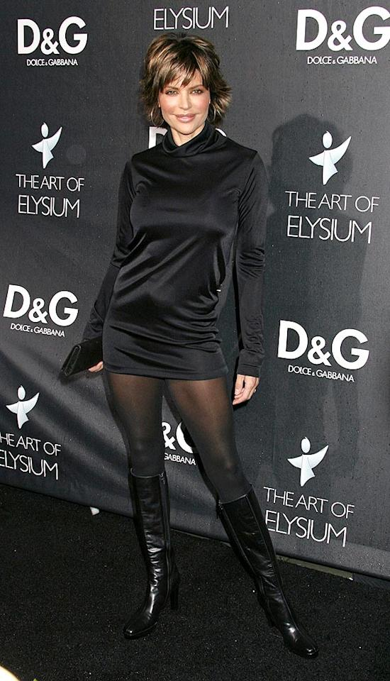 "The perennially pouting Lisa Rinna showed off her gams in a super short dress and knee-high boots. Russ Einhorn/<a href=""http://www.splashnewsonline.com"" target=""new"">Splash News</a> - December 15, 2008"