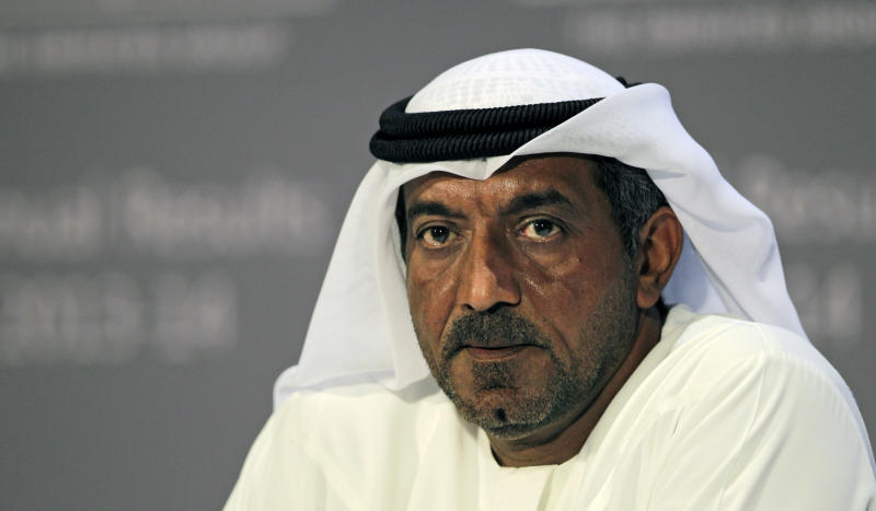 Sheik Ahmed bin Saeed Al Maktoum, Emirates' chairman and CEO, listens during a news conference in Dubai, United Arab Emirates, Thursday, May 8, 2014. The parent company of the Middle East's biggest airline, Emirates, posted an annual profit Thursday of $1.1 billion as it enjoyed a dip in fuel costs and boosted capacity with the addition of two dozen new planes. (AP Photo/Kamran Jebreili)