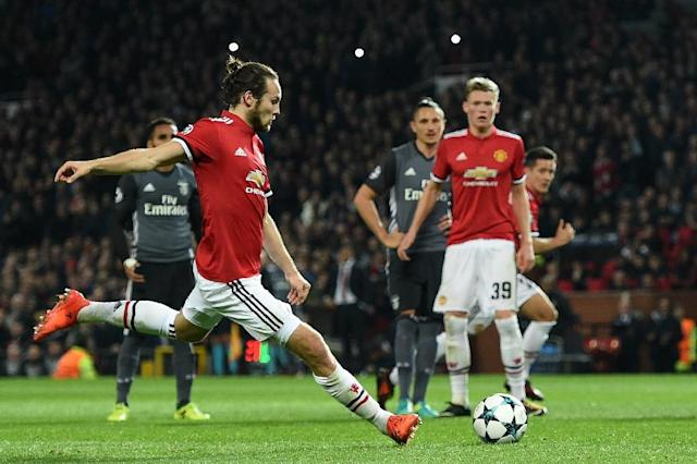 Manchester United's Daley Blind scores a goal from the penalty spot during their UEFA Champions League Group A second leg match against Benfica, at Old Trafford in Manchester, on October 31, 2017 (AFP Photo/Oli SCARFF )
