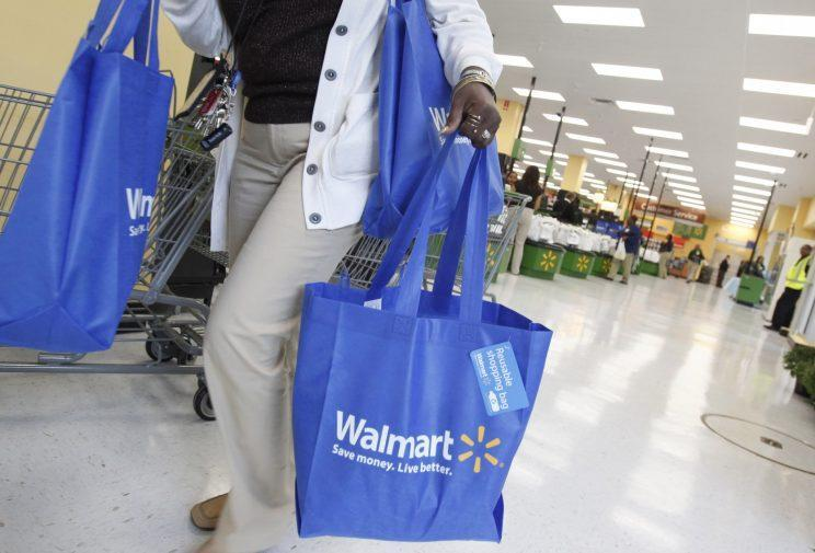 A shopper carries her purchases from a newly opened Walmart Neighborhood Market in Chicago. (Reuters/Jim Young)