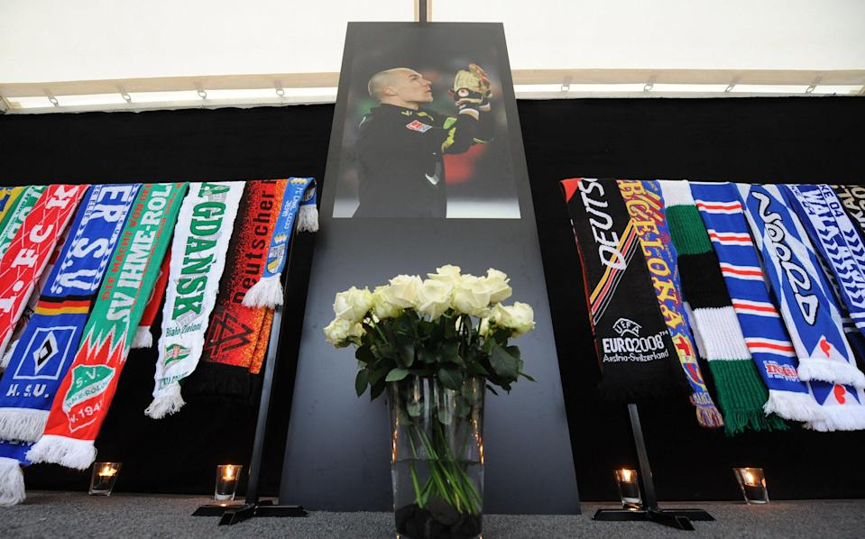 Football souvenirs commemorating former German goalkeeper Robert Enke pictured on November 10, 2010 at the AWD Arena stadium in Hanover (AFP Photo/Peter Steffen)