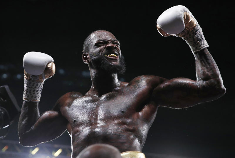 Deontay Wilder celebrates after defeating Luis Ortiz in the WBC heavyweight title boxing match Saturday, Nov. 23, 2019, in Las Vegas. (AP Photo/John Locher)