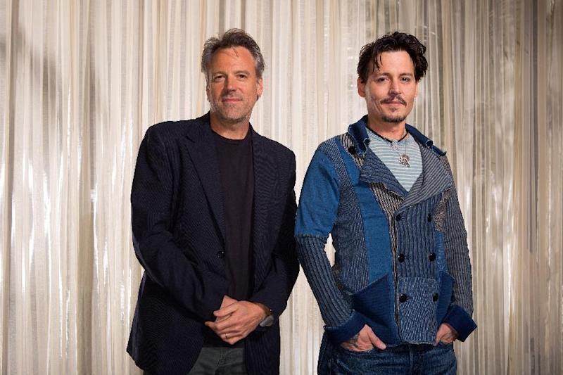 "This Saturday, April 5, 2014 photo shows actor Johnny Depp, right, and director Walter Pfister during the ""Transcendence"" film press junket at the Four Seasons Hotel, in Los Angeles. For more than a decade the cinematographer Pfister has been bringing director Christopher Nolan's cinematic visions to life, but now he's the one calling the shots. His directorial debut ""Transcendence"" has many elements of a Nolan blockbuster, with eye-popping visual effects, a mind-bending story and an A-list lead in Depp. (Photo by Zach Cordner/Invision/AP)"