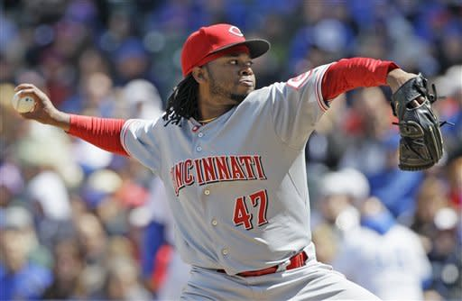 Cueto helps Reds beat Cubs 4-3
