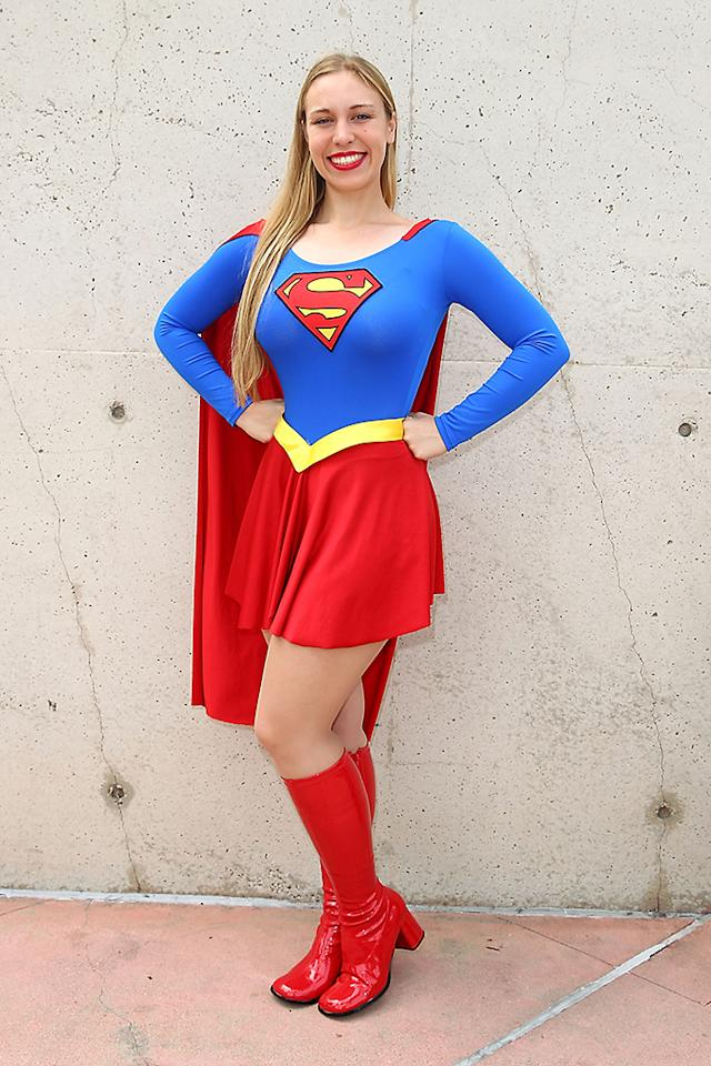 SAN DIEGO, CA - JULY 20:  A guest in a Superwoman costume attends Comic-Con International 2013 - Day 3 on July 20, 2013 in San Diego, California.  (Photo by Joe Scarnici/FilmMagic)