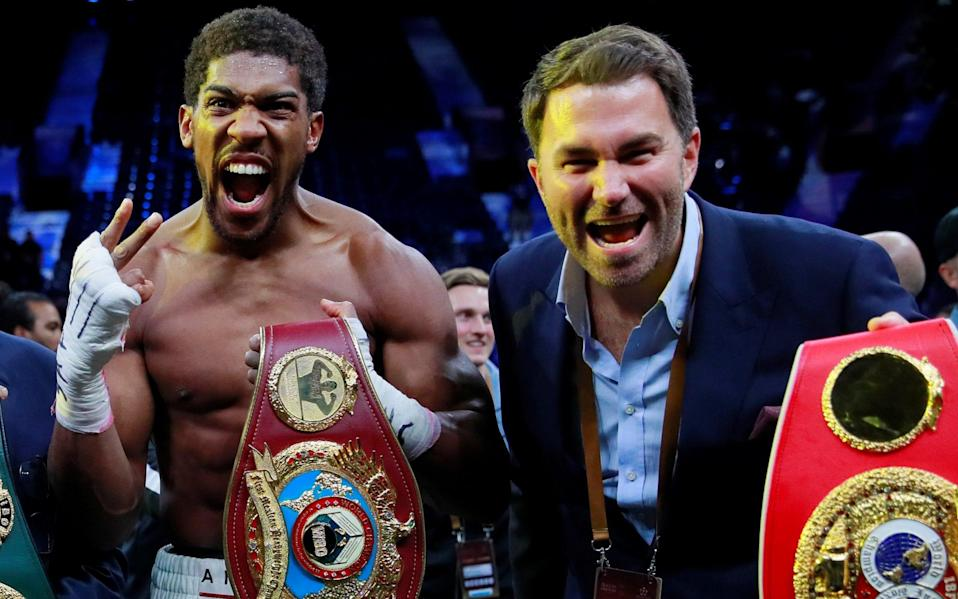 Promoter Eddie Hearn and Anthony Joshua celebrate - ACTION IMAGES
