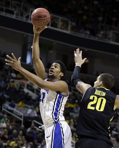 Saint Louis forward Dwayne Evans, left, shoots over Oregon's Waverly Austin (20) during the first half of a third-round game in the NCAA college basketball tournament Saturday, March 23, 2013, in San Jose, Calif. (AP Photo/Ben Margot)