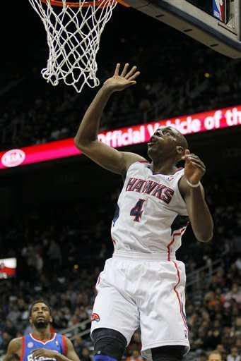 Atlanta Hawks power forward Anthony Tolliver (4) shoots in first-half action of an NBA basketball game against the Philadelphia 76ers, Wednesday, March 6, 2013, in Atlanta. The Hawks won the game 107-96. (AP Photo/Todd Kirkland)