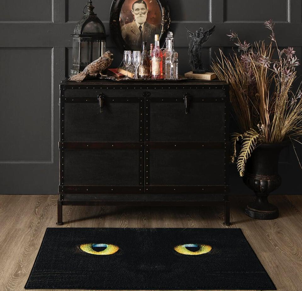 """<p>OK, the eyes on this skid-resistant <span>Black Cat Rug</span> ($32) are almost <em>too</em> realistic. If you're hoping to repurpose it next <a class=""""link rapid-noclick-resp"""" href=""""https://www.popsugar.com/Halloween"""" rel=""""nofollow noopener"""" target=""""_blank"""" data-ylk=""""slk:Halloween"""">Halloween</a>, simply throw the rug in the washing machine prior to storage.</p>"""
