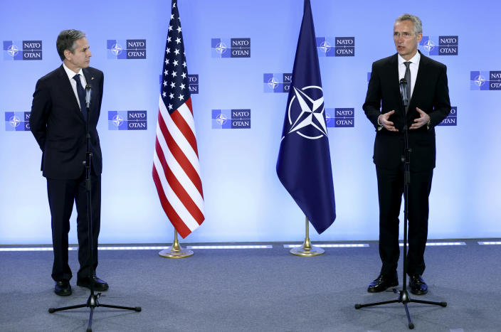 NATO Secretary General Jens Stoltenberg, right, and United States Secretary of State Antony Blinken participate in a media conference at NATO headquarters in Brussels, Wednesday, April 14, 2021. United States Secretary of State Antony Blinken is in Brussels on Wednesday for talks with European and NATO allies about Afghanistan, Ukraine and other matters. (Kenzo Tribouillard, Pool via AP)