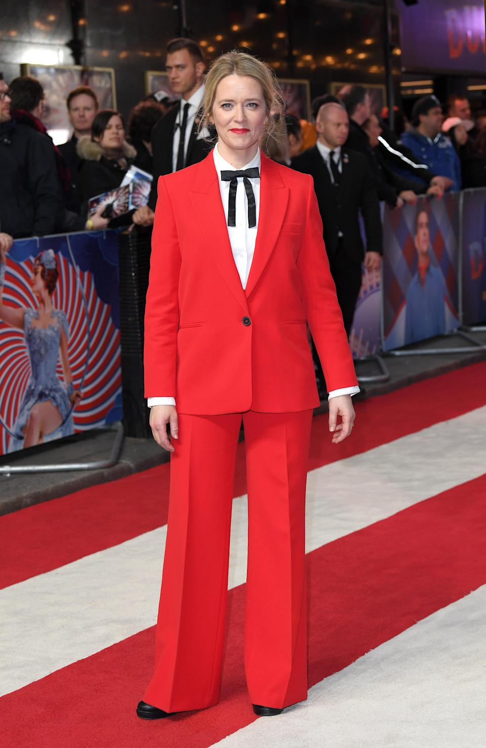 <p>The television presenter wore a red trouser suit, white shirt and black neck tie on the red carpet for the 'Dumbo' premiere in London. <em>[Photo: Getty]</em> </p>